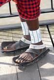 A member of the fastest group of Maasai Warriors to complete a Marathon. Their shoes are made of old tyres.