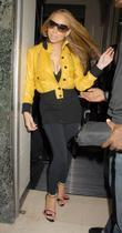 Mariah Carey and leaving Claridges hotel.