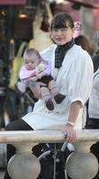 Milla Jovovich, Her Baby and Mother Stroll Through The Grove Outdoor Shopping Mall.