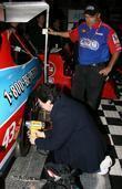 Nascar fan changes a tire