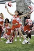 Child dancers perform High School Musical routines in front of Tower Bridge