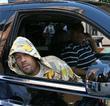 American rapper Redman (aka Reginald 'Reggie' Noble) sitting...