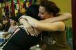 Amanda Palmer of The Dresden Dolls hugs a...