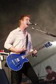 josh homme from queens of the stone age performing