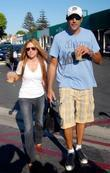 Brad Garrett and his girlfriend drinking coffee whilst...