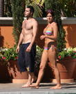 Danielle Lloyd, her friend Owen Beiny sunbath by a hotel pool