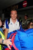 Scottish track cyclist Chris Hoy arrives at Manchester airport greeted by awaiting fans
