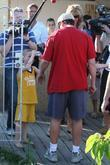 Adam Sandler faces a mini-paparazzo promoting his new...