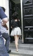 Amy Winehouse arrives at her lawyers office dressed...