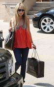 Ashley Tisdale shops at Barneys with her mother...