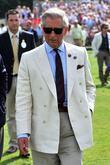 Prince Charles treading the divots Cartier International Polo...