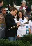 Michael C. Hall signs an autograph before promoting...