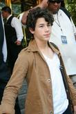 Nick Jonas The Jonas Brothers are greeted by...