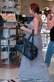 A pregnant Ashlee Simpson goes shopping with a...