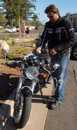 Dean McDermott gets ready to leave on his motorcycle
