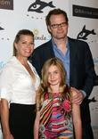 Beth Toussaint and Jack Coleman with their daughter...