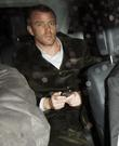 Guy Ritchie arrives home after filming on the...