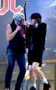 Brian Johnson and Angus Young of AC/DC performing...