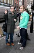 Alan Carr gives a man directions in Soho...