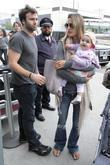 Alessandra Ambrosio, Jamie Mazur arrive at LAX airport with daughter Anja Louise to catch an American Airlines flight