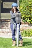 Alyson Hannigan puts money in a parking meter...