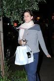 Amanda Peet, wearing no makeup, carrying her dinner...