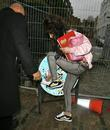 Amy Winehouse  adjusts her trainer as she...