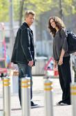 Andrew Castle greets a female friend as he...