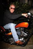 Peter Fonda poses on a Harley Davidson Motor Cycle