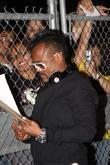 Apl.De.Ap signs autographs Black Eyed Peas perform at...
