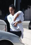Camilla Alves' son Levi carried by his nanny...