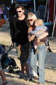 Tori Spelling and Dean McDermott with their son...