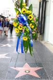 A Flower Arrangement Has Been Placed At The 'munchkins' Star On The Hollywood Walk Of Fame To Remember Clarence Swensen, Star On The Hollywood Walk Of Fame and Walk Of Fame