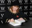 Dawn French signs copies of her new book...