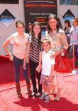 Mimi Rogers and family