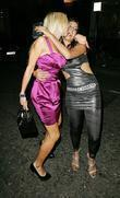 Alicia Douvall and Guest leaving the Embassy Club...