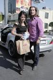 Fabio, his female friend get into his parked car at Sunset Plaza after doing some shopping