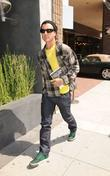 Gavin Rossdale walking around Beverly Hills holding a...