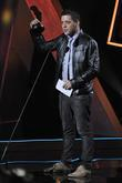 George Stroumboulopoulos accepting an award at