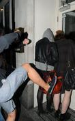Pixie Geldof, A Friend Are Huddled In A Corner While A Drunk Passer By Hurles Abuse and Attempts To Kick The Pair. Pixie Was Leaving Groucho Club After A Night Out With Friends.