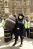 A Demonstrator Dresses Up As Guy Fawkes Outside The Houses Of Parliament Protesting Against The Recent Mp's Expenses Scandal