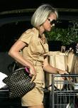 Johnny Hallyday and His Wife Laeticia Walk Back To Their Car After Grocery Shopping At Bristol Farms In Beverly Hills