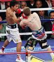 Manny Pacquiao knocks out Ricky Hatton in 2:59 seconds in the second round at the MGM Grand Garden Arena. Referee Kenny Bayless stopped the fight.