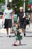 Hugh Jackman, carrying a picnic blanket, his wife Deborra-Lee take daughter, Ava Eliot and for a scooter ride