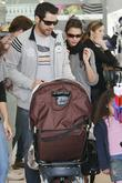 Jessica Alba, Cash Warren out, about at the Fairfax Flea Market with family, friends wearing ripped jeans