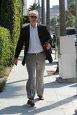John Lithgow walking in Beverly Hills after having...