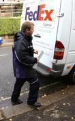 A Fedex Courier Collects A Package From The Home Of Jonathan Ross