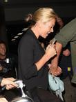 Kate Moss with her boyfriend arriving at LAX...