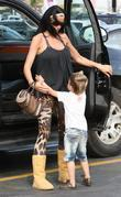 Katie Price, Junior go for lunch at Gladstones 4 Fish. Katie appears to be wearing a pair of Ugg boots and leopard print leggings.