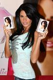 Katie Price poses for photos and signs autographs...